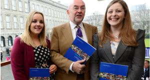 Minister for Education Ruairí Quinn, with TAP graduates  Lyndsey Johnson and Siobhan O'Brien,  launches a report marking 20 years of the Trinity Access Programme. Photograph: Bryan O'Brien