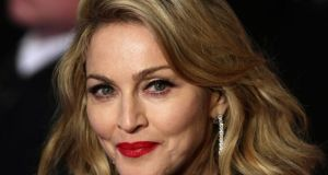 "Madonna  said she is ""saddened"" by criticism of her charity work in Malaw"