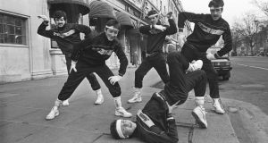 The original caption from March 20th 1985: DANCING IN THE STREET:  The Dizzy Footwork breakdance team in O'Connell Street, Dublin.  The team (from left), John Mansfield, Pat Daly, Brian Waters, Alan Dunnigan and Daniel Tracey, are part of the National Federation of Youth Clubs roadshow, which launched at the Gresham Hotel last night in celebration of International Youth Year.  Photograph: Matt Kavanagh