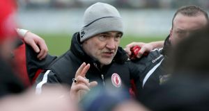 Tyrone manager Mickey Harte speaks to his players after their league meeting earlier this season.