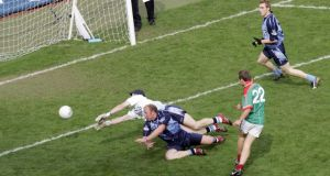 Mayo's Andy Moran scores a goal past Stephen Cluxton and Shane Ryan in the 2006 game. Photograph: Donall Farmer/Inpho