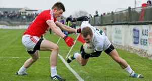 Kildare's Alan Smith is bundled over the sideline by Conor Gormley during the league game in Newbridge last month. Photograph: Morgan Treacy/Inpho