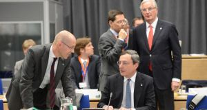 Jörg Asmussen, a member of the European Central Bank executive board, speaking to ECB president Mario Draghi at the  Ecofin meeting  at Dublin Castle yesterday. Photograph: Alan Betson
