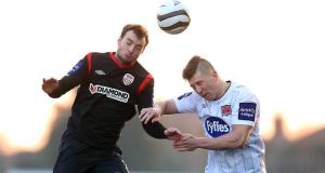 Thomas Crawley of Derry City wins a header ahead of John O'Sullivan of Dundalk. Photograph: Donall Farmer/Inpho