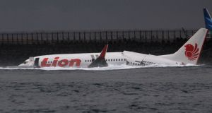 A Lion Air plane is seen in the water after it missed the runway in Denpasar, Bali. Photograph: Reuters/Stringer.