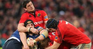 Munster's James Downey, Stephen Archer and Tommy O'Donnell tackle Seán O'Brien of Leinster. Photograph: Cathal Noonan/Inpho