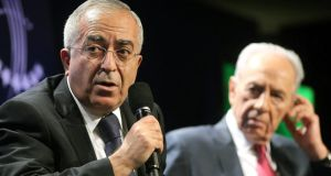 Outgoing Palestinian prime minister Salam Fayyad (left) has tendered his resignation to president Mahmoud Abbas. Photograph: Getty