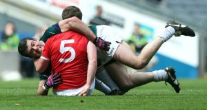 Pádraig O'Neill of Kildare grapples with Dermot Carlin of Tyrone. Photograph: Donall Farmer/Inpho