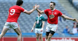 Tyrone's Mark Donnelly celebrates scoring his sides second goal against Kildare with Seán Cavanagh. Photograph: Donall Farmer/Inpho