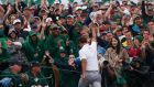 Adam Scott of Australia is applauded as he walks off the 18th green after sinking a birdie putt. Photograph: Mike Segar/Reuters