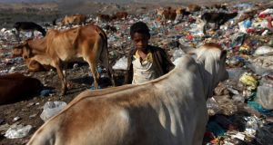 A boy walks at a garbage disposal site in  Yemen. Photograph: Mohamed al-Sayaghi/Reuters
