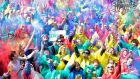 Stop this! Too silly! Hundreds of people in variously coloured ponchos throw water balloons and multi-coloured powder about on the streets of Dublin for the launch of The Ministry of Silly Ideas, which forms part of the Laya Healthcare Street Performance World Championships taking place in Dublin and Cork in July. Photograph: Dave Meehan/The Irish Times