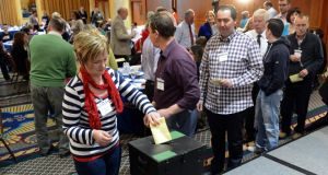 Voting  at the Convention on the Constitution meeting in Malahide, Co Dublin yesterday. It recommended that the Constitution should be changed to allow for civil marriage for same-sex couples. Photograph: Eric Luke / THE IRISH TIMES