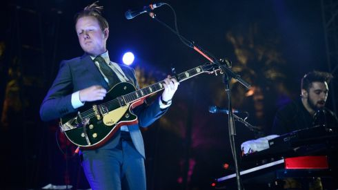 Alex Trimble looking classy with Two Door Cinema Club. Photograph: Frazer Harrison/Getty Images