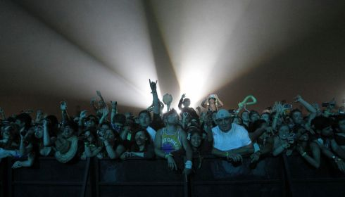 Soaking up the atmosphere: gig-goers watch the Red Hot Chili Peppers at Coachella. Photograph: Mario Anzuoni/Reuters