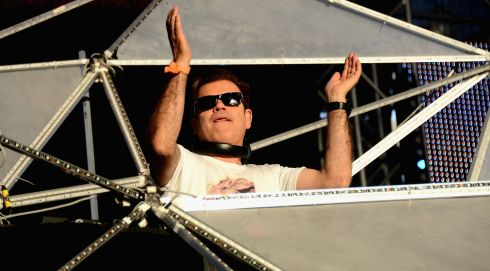 Putting a spin on it:  DJ Paul Oakenfold onstage. Photograph: Mark Davis/Getty Images