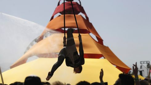 A performer on the ropes at Coachella.  Photograph: Mario Anzuoni/Reuters