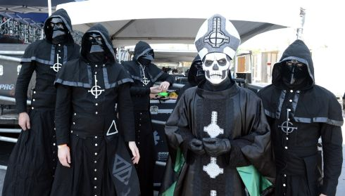 You shall not have absolution: Papa Emeritus II and the Nameless Ghouls of Ghost B.C. backstage.  Photograph: Kevin Winter/Getty Images