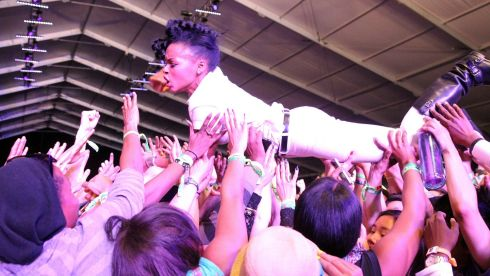Janelle Monae rides the crest of...well, many hands, during her performance. Photograph: Karl Walter/Getty Images