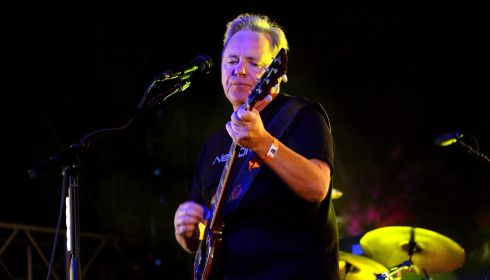 Bernard Sumner fronts New Order's show. Photograph: Jason Kempin/Getty Images
