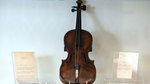 Wallace Hartley's violin is displayed at  auctioneers Henry Aldridge & son. The auction house has apparently spent seven years proving the violin genuinely belonged to Hartley, who with his orchestra famously played as the Titanic sank in April 1912, and  died with so many others. Long thought to have been either lost at sea or stolen, it is being described as one the most important Titanic-related pieces that has ever come up for sale and is thought to be worth a six-figure sum. It is the property of an unidentified individual in Lancashire.  Photograph: Matt Cardy/Getty Images