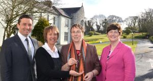 John Concannon and Jacquie Horan of Cope Galway accept the keys to the former laundry building from Sr Elizabeth Manning and Sr Caitlin Conneely of the Sisters of Mercy. Photograph: Joe Travers