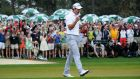 Adam Scott of Australia celebrates after he sinks a birdie putt on the 18th during the fourth round of the 77th Masters golf tournament at Augusta National. Photograph: Jim Watson/AFP/Getty Images