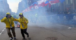 Moments after the explosion near the finish line of the Boston Marathon. Photograph: John Tlumacki/The Boston Globe
