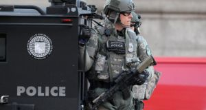 SWAT officers patrol the Copley Square area after explosions near the finish line of the Boston Marathon in Boston, Massachusetts yesterday. Photograph: Reuters