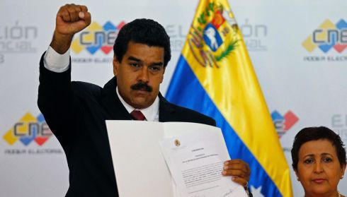 Venezuela's President-elect Nicolas Maduro gestures defiantly as he holds a certificate confirming him as winner in the election of April 14th. Photograph: Carlos Garcia Rawlins/Reuters
