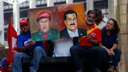 Supporters of Venezuela's President-elect Nicolas Maduro hold his portrait along with one of Hugo Chavez during a demonstration in the former's favour in Caracas on April 15th. Photograph: Marco Bello/Reuters