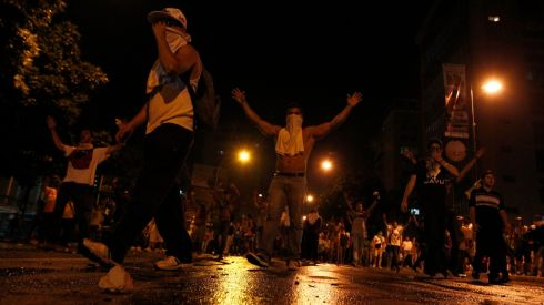 Supporters of opposition leader Henrique Capriles block a street. Photograph: Carlos Garcia Rawlins/Reuters