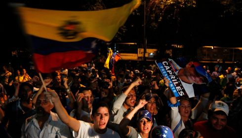 Supporters of Venezuela's opposition leader Henrique Capriles yell slogans outside his campaign headquarters in Caracas on April 15th. Photograph: Carlos Garcia Rawlins/Reuters