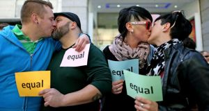 Gay couples kiss outside the Gaiety Theatre, in Dublin, at a photocall last Sunday to coincide with the constitutional convention. Photograph: Julien Behal/PA Wire