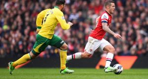 Bradley Johnson (Norwich City) competes for the ball against Jack Wilshere (Arsenal) during the Barclays Premier League match at Emirates Stadium. Photograph: Mike Hewitt/Getty Images