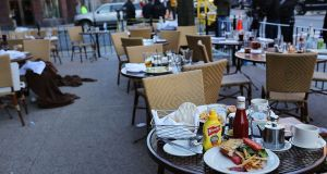 Meals sit uneaten with no one as yet to clear them up at at a nearby cafe on the morning after the Boston Marathon bombings.  Photograph: Spencer Platt/Getty Images