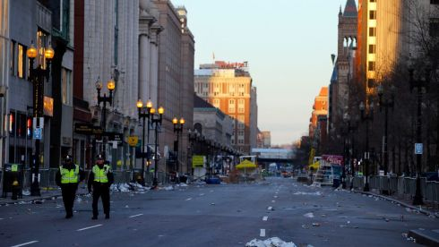 Two police officers walk down Boylston Street, away from the finish line of the Boston Marathon, on the morning after the fatal bomb attacks. Photograph: Brian Snyder/Reuters