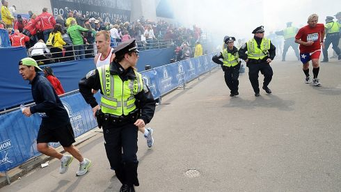 Police and runners react to the blasts. Photograph: Ken McGagh/MetroWest Daily News/Reuters