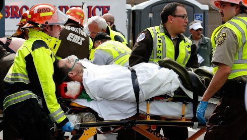 An injured man is loaded into an ambulance. Photograph: Jim Rogash/Getty Images