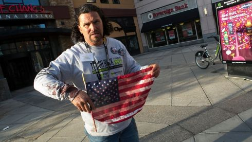 Carlos Arredondo, who aided victims after explosions at the Boston Marathon, holds a bloodied American flag. Photograph: Katherine Taylor/The New York Times
