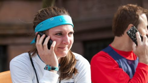 Serri Swords, of Westfield, Massachussets, tries to contact other people she knows who were running in the Boston Marathon after the explosions. Photograph: Katherine Taylor/The New York Times