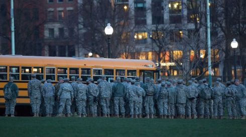 National Guard troops gather near Boston Common before going on a sweep near the scene of the bombings. Photograph: Scott Eisen/Reuters