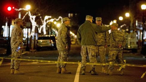 Soldiers cordon off an area of downdown Boston overnight. Photograph: Josh Haner/The New York Times