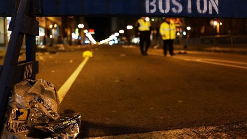 Police patrol the deserted blast zone at night. Photograph: Spencer Platt/Getty Images