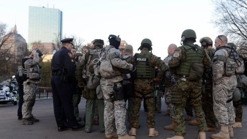 Swat team members and special police units assemble at Boston Common early on the morning after the Boston Marathon bombings. Photograph: Darren McCollester/Getty Images