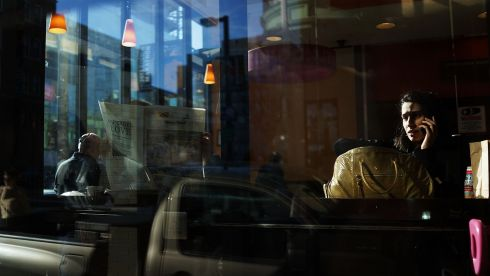 A woman sits in a restaurant near the site of the Boston Marathon bombings on the morning afterwards. Photograph: Spencer Platt/Getty Images