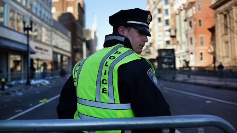 A Boston police officer looks over his shoulder on the morning after the Boston Marathon bombings. Security is high in the city in the wake of the attack. Photograph: Spencer Platt/Getty Images