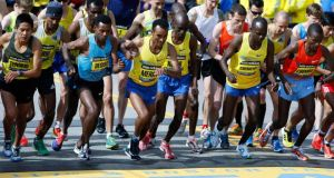 'Like many Kenyans, Korir (above, third from right, participating in the Boston Marathon)   had much to run from, including an impoverished childhood, during which he sometimes needed the help of Fr Willie Walshe and others to pay his school fees.'  Photograph: Reuters/Dominick