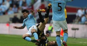 Manchester City's Sergio Aguero  lunges in on Chelsea's David Luiz  during last Sunday's FA Cup semi-final at Wembley Stadium. The challenge generated much post-match comment with Luiz calling for an apology. Nick Potts/PA