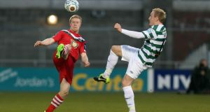 Derek Foran of Shamrock Rovers challenges Daryl Horgan of Cork City. Photograph: Donall Farmer/Inpho